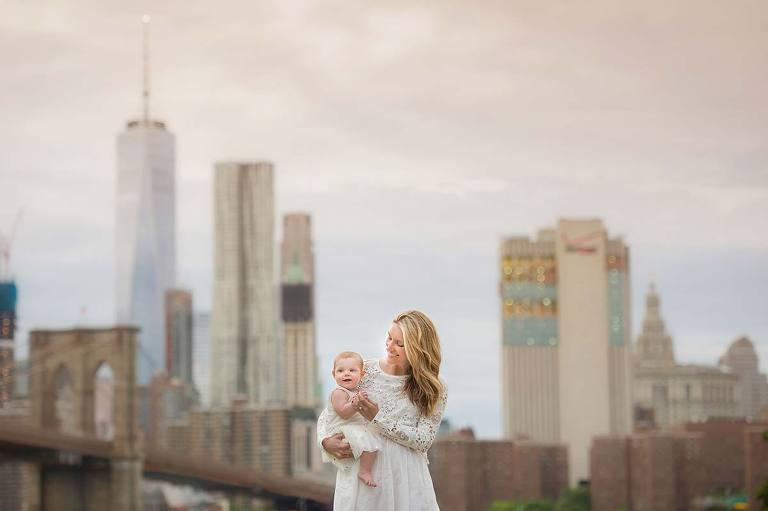 Downtown Manhattan is the perfect backdrop for this bonding moment between a mother and her daughter.