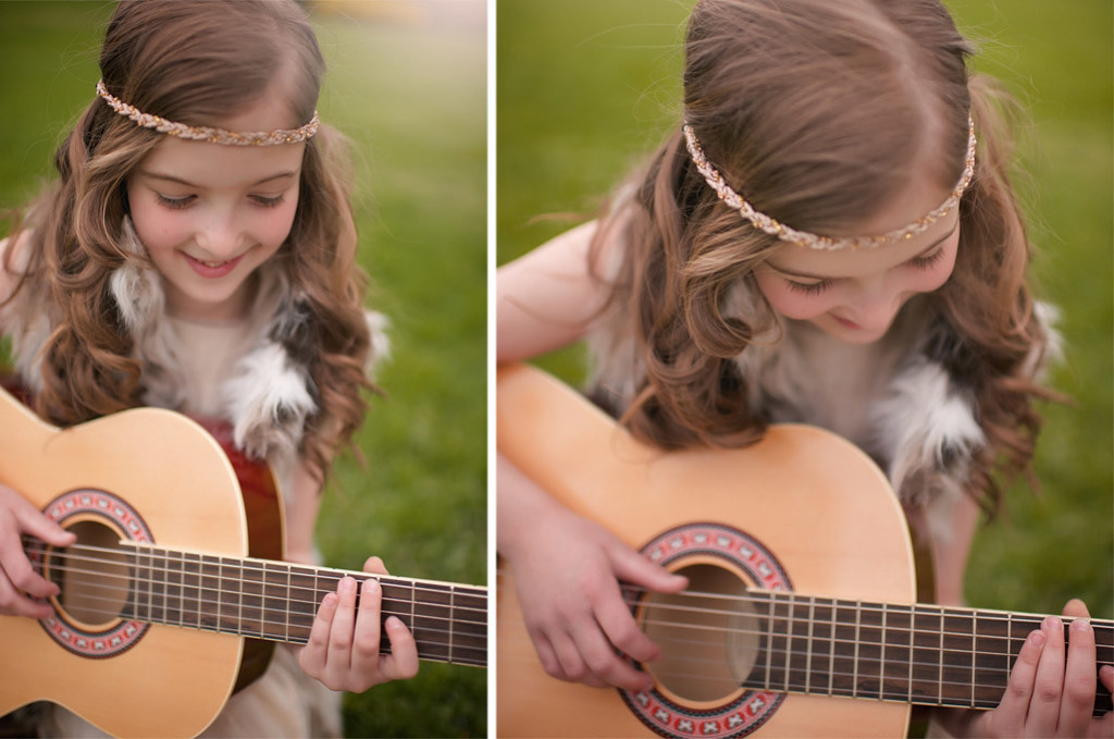 girl playing guitar in arboretum