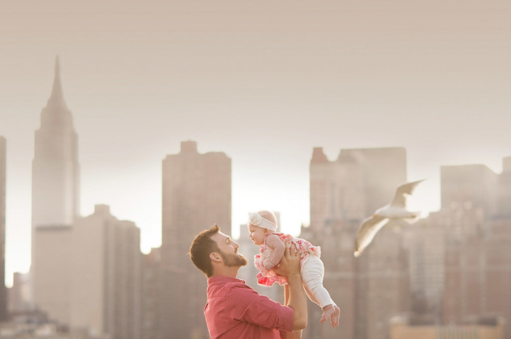 father and daughter with nyc skyline