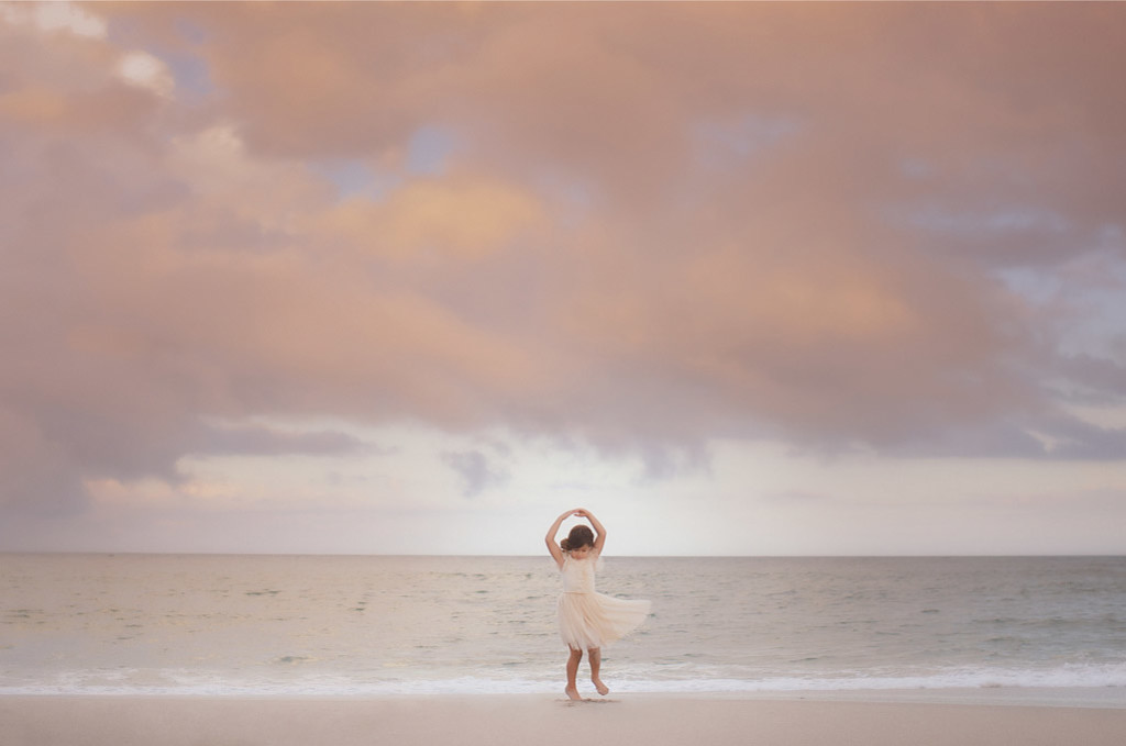 little girl dancing on the beach in nyc
