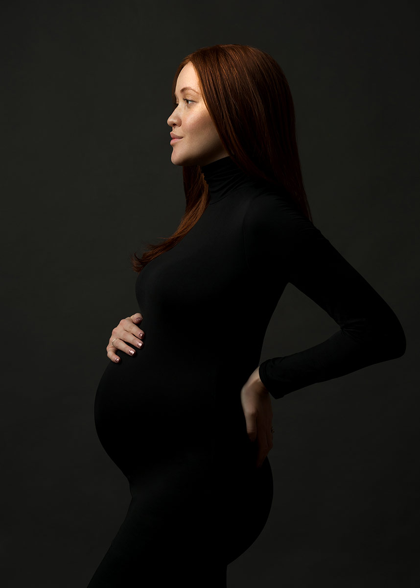 black fitted turtleneck dress pregnant woman