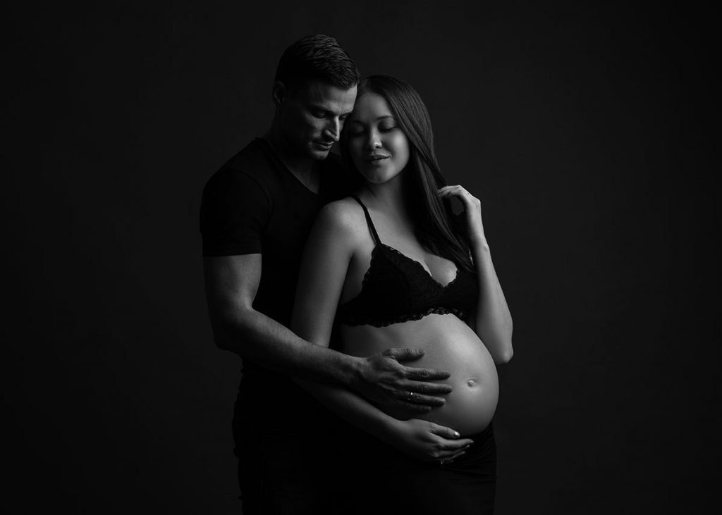 pregnant woman husband holding belly nyc