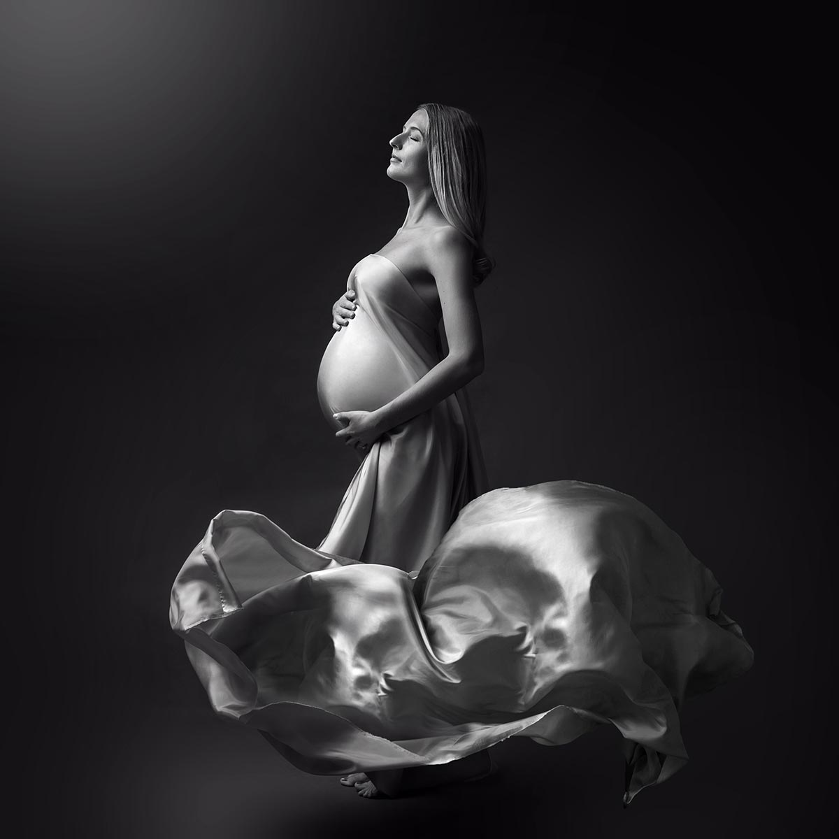 voluminous fabric pregnant woman standing for maternity portrait
