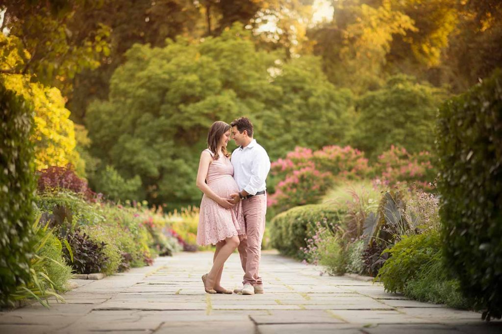 Lifestyle portrait of a husband and wife in the Conservatory Gardens, Central Park NYC.