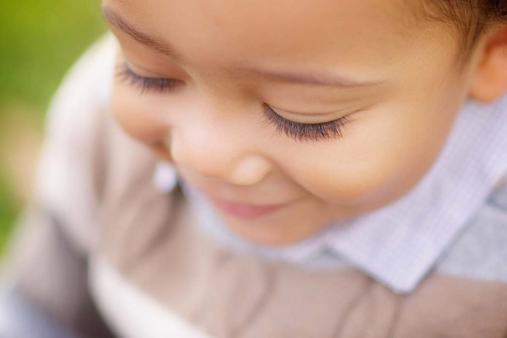 Closeup image of a young boy and his eyelashes.