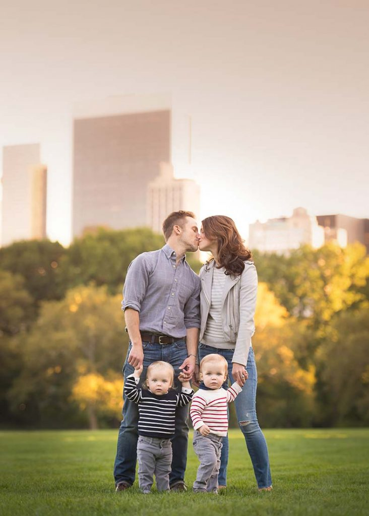 Beautiful family portrait with two children and NYC skyline.