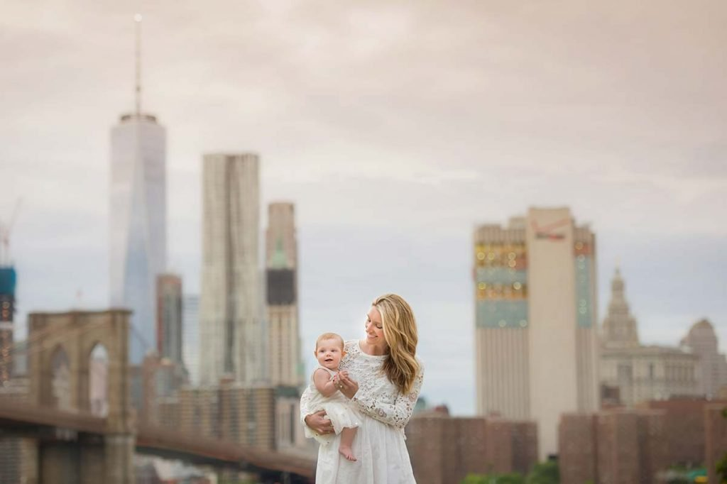 A stylish Mom playing with her baby near NYC Downtown