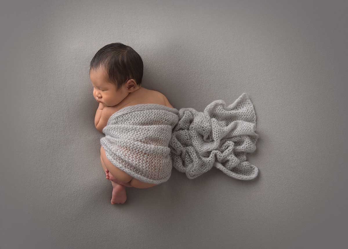 Baby sleeping at a photography studio