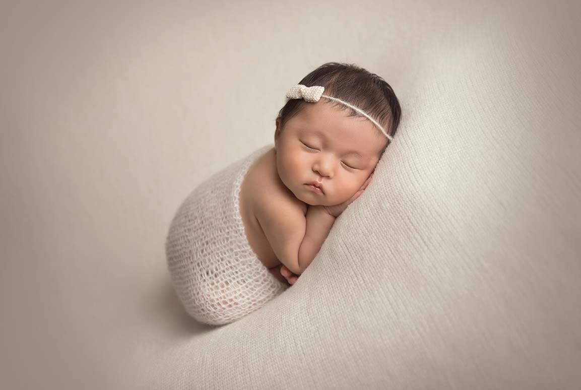 Baby in a knit wrap sleeping