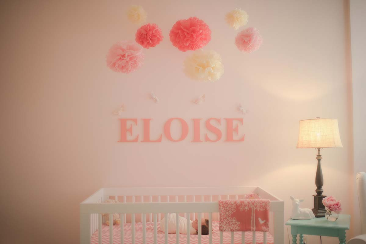 Baby sleeping in a crib at a beautifully designed nursery