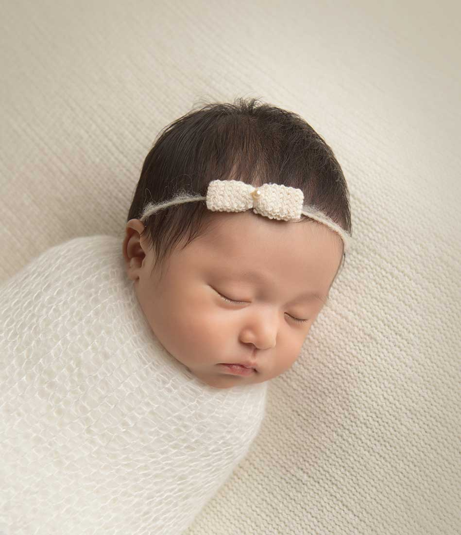 Cute infant sleeping with a headband