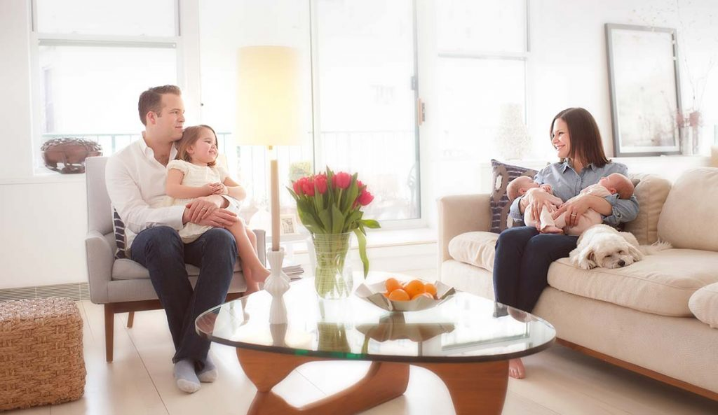 Lifestyle photo of a family enjoying a happy moment in their sunlit living room
