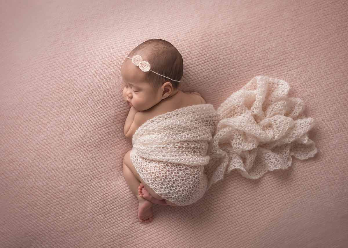 Newborn in a blanket at a NYC photo studio