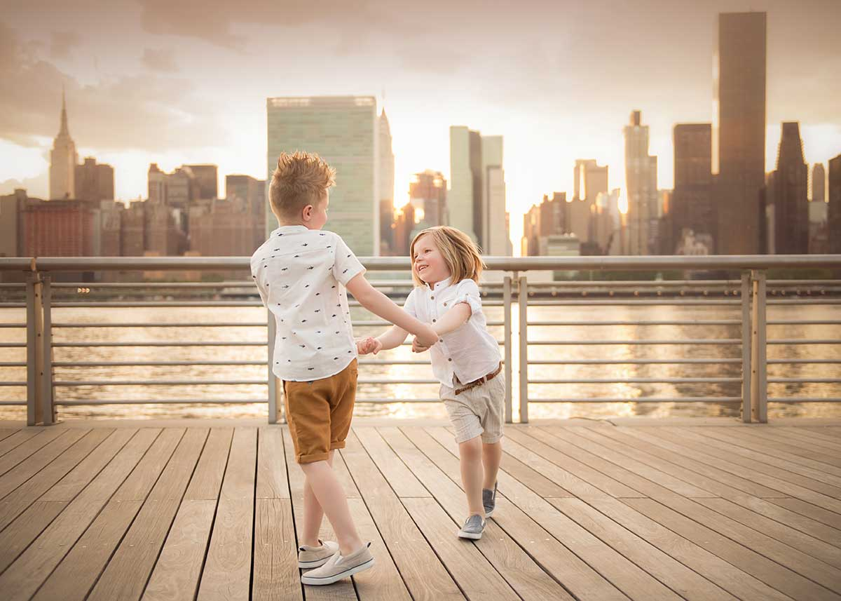 Two brothers dancing on a pier in Long Island City