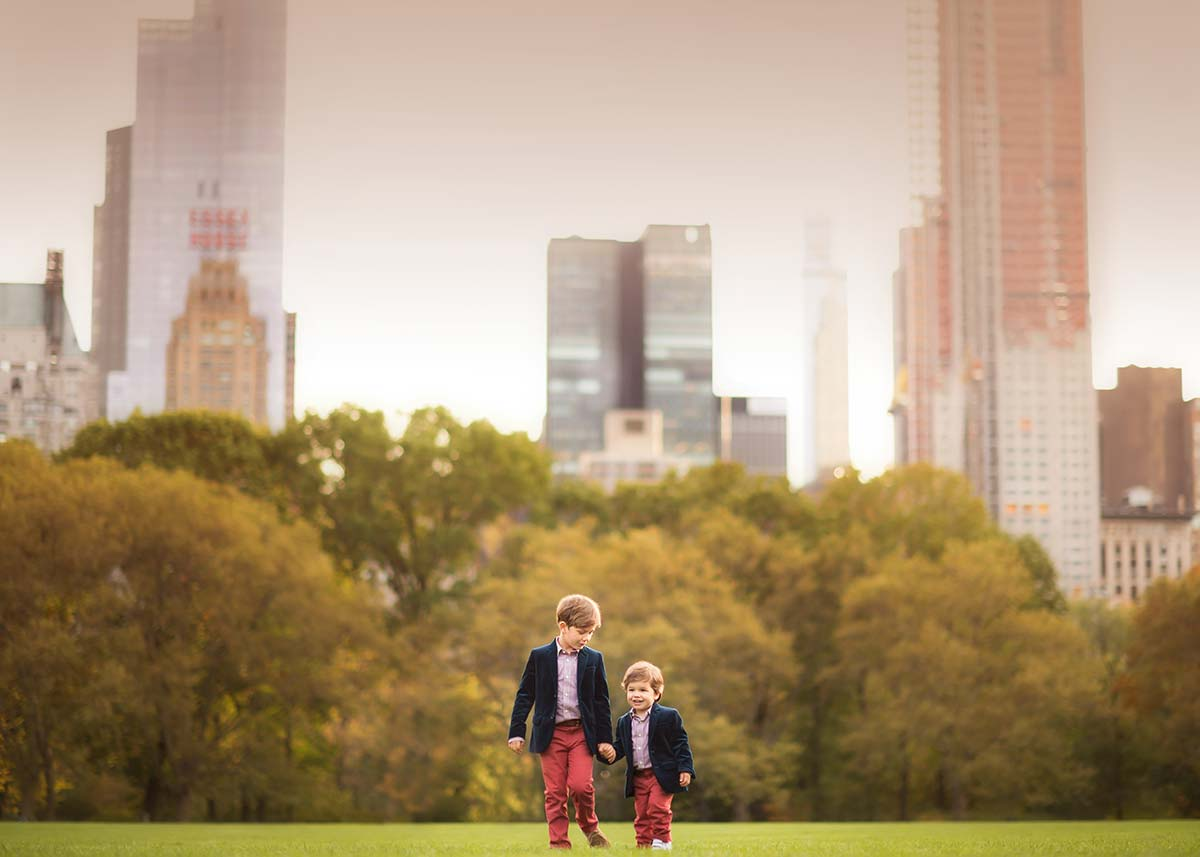 Two stylish baby brothers walking in Sheep Meadow NYC