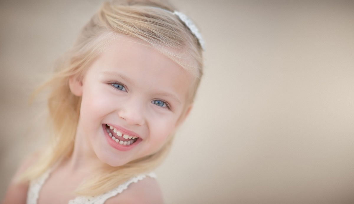 Closeup of a young blonde girl smiling