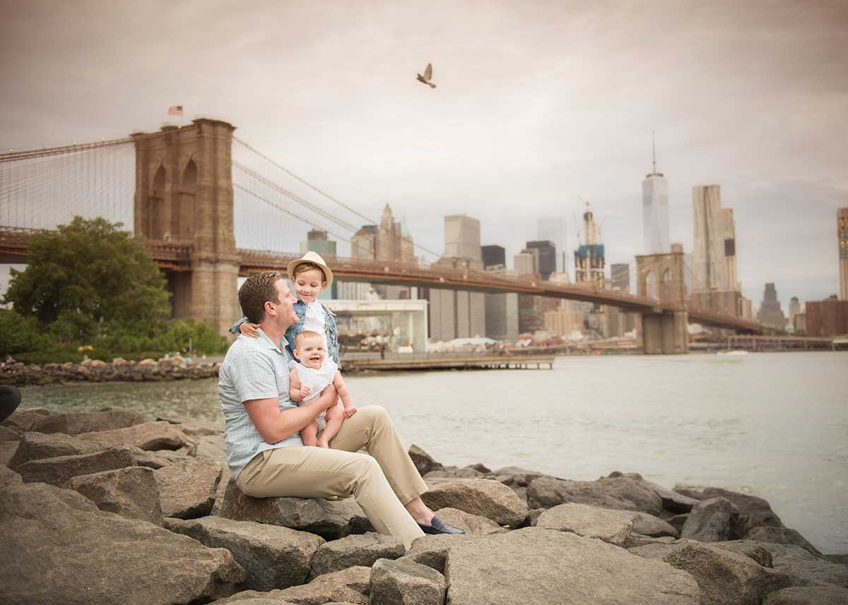 Happy family photo taken near Brooklyn Bridge NYC