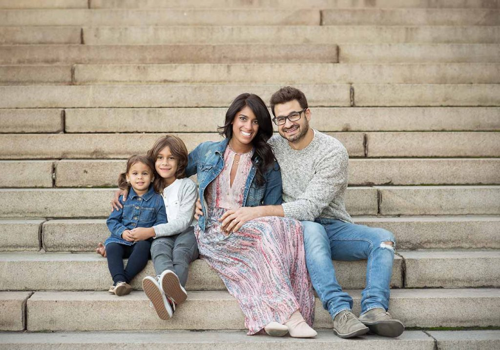 Beautiful family photo with two children taken on stairs at Bethesda Fountain NYC