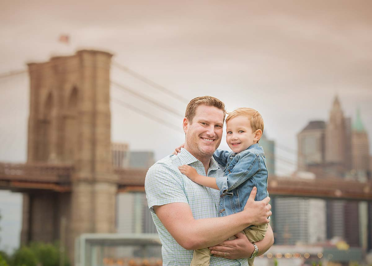 Father and his toddler boy posing for photos near Brooklyn Bridge