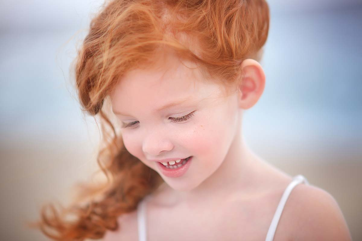 Girl with red hair smiling