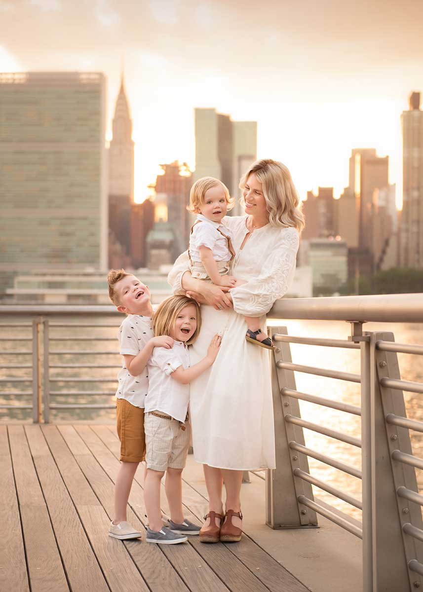 Mother posing with her children by a NYC waterside park