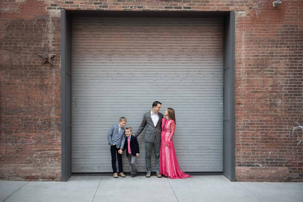 Stylish NYC family posing in Dumbo Brooklyn NYC