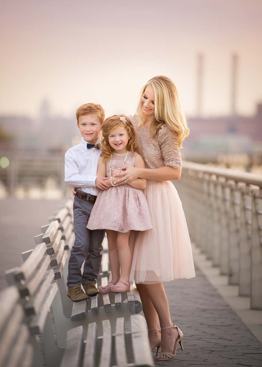 Stylish family posing for a portrait in NYC