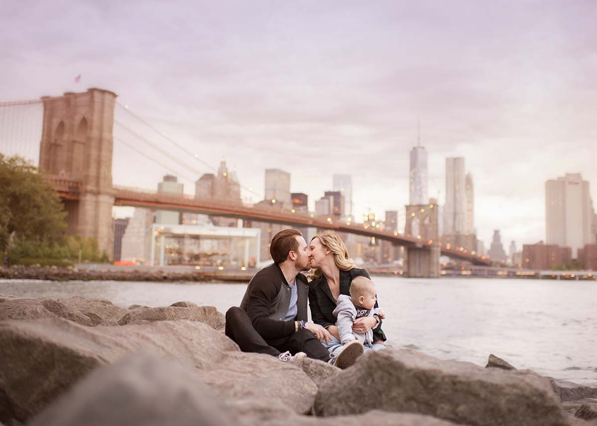 Brooklyn Family sitting on the shore near East River NYC