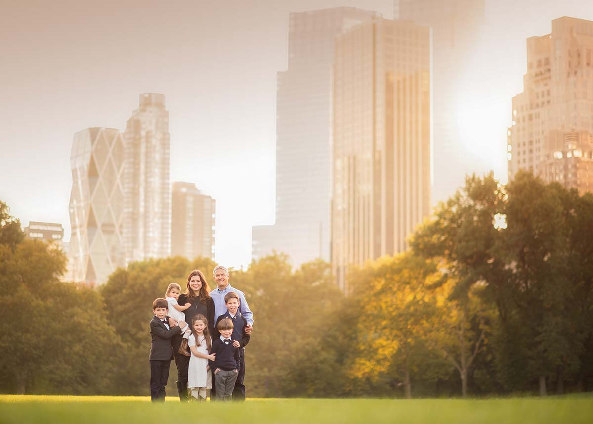 Large family portrait set amidst the majestic NYC skyline