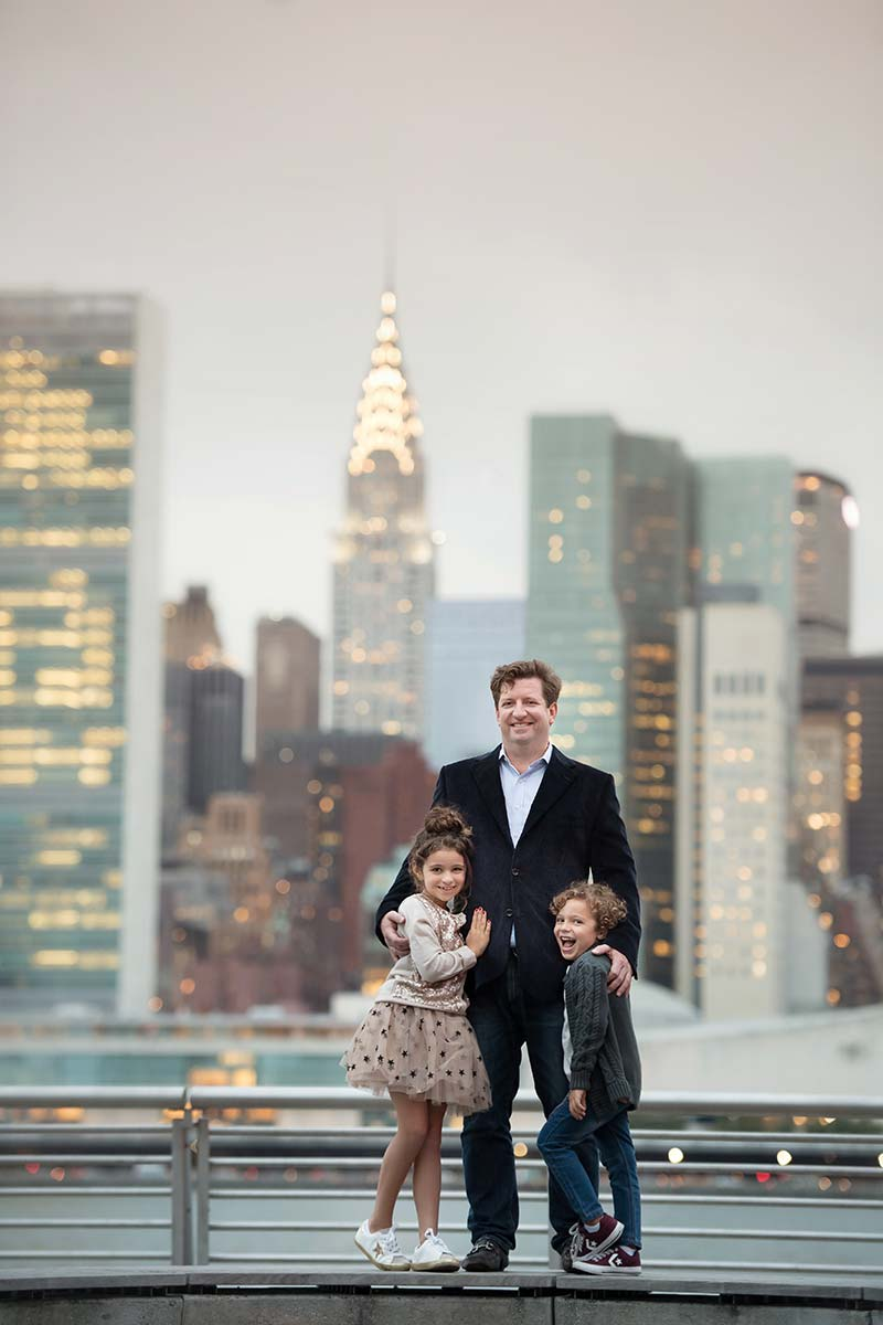 Father posing with his beautiful children with the Chrysler Building in the background
