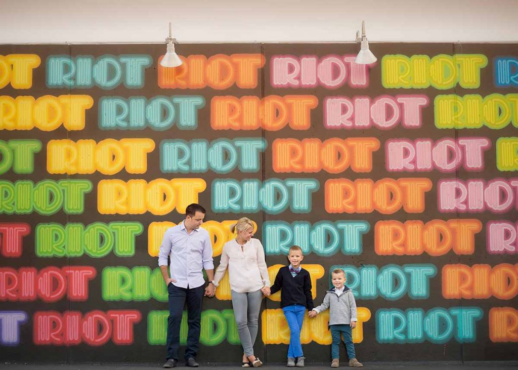 Colorful Riot display at Coney Island NYC with a family