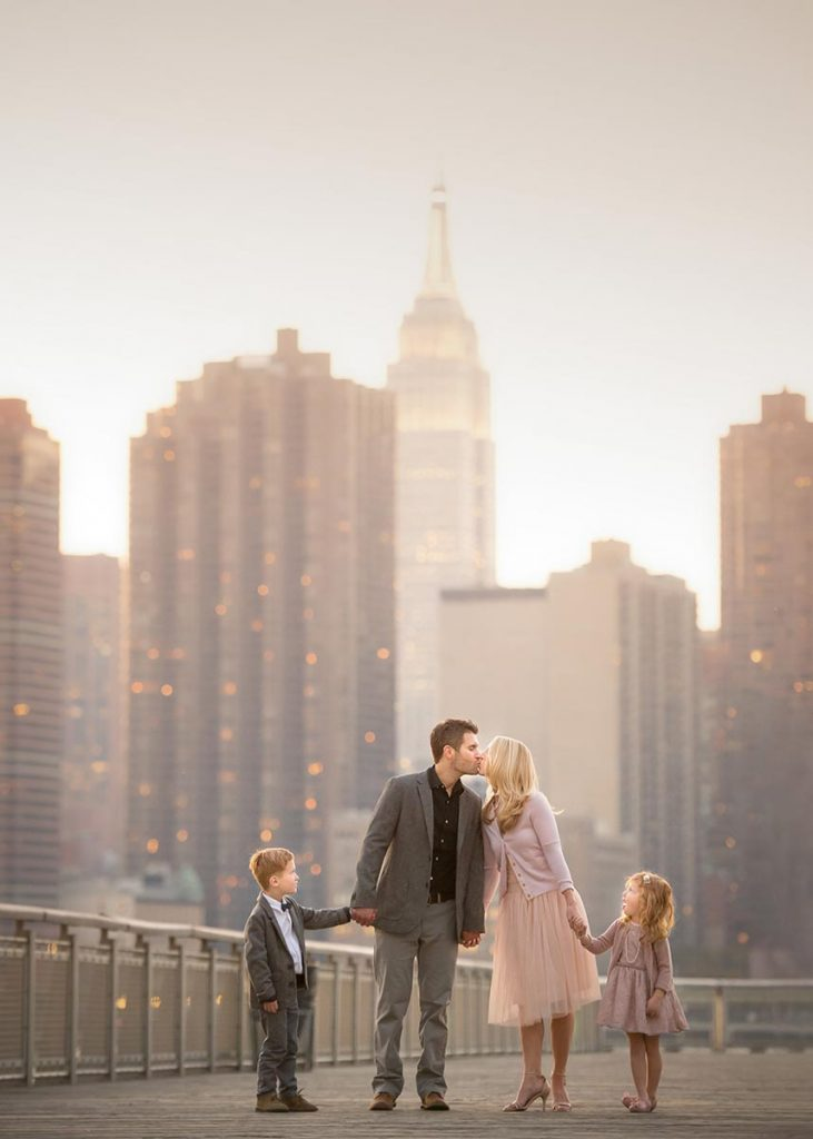 Majestic portrait of a family with Empire State Building in the background