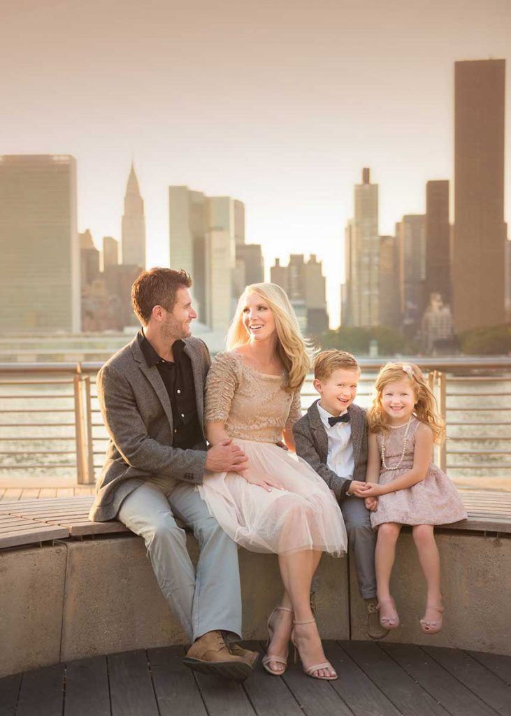 Happy moment of a Mom and Dad smiling with their two children in NYC