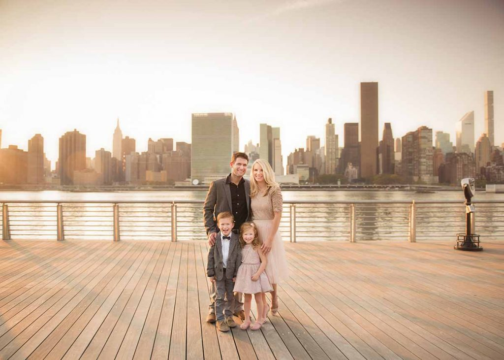 Stunning family portrait with NYC skyline and East River