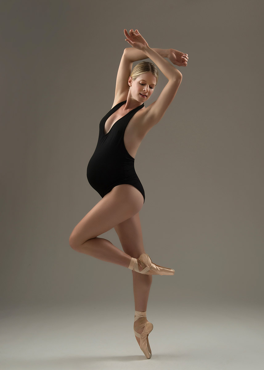 Ballerina posing for her maternity portrait in NYC photo studio