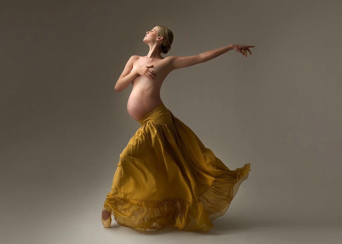 Pregnant ballerina in a yellow skirt