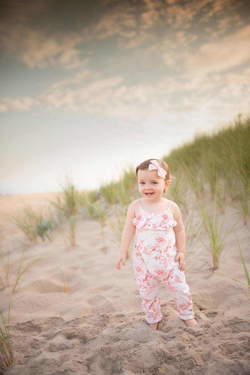 Young girl smiling at the beach in the Hamptons