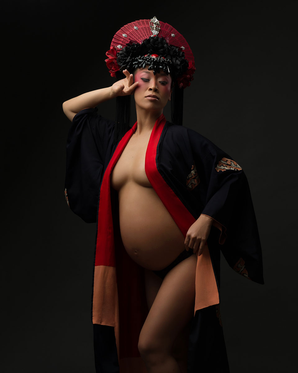 Maternity portrait of a woman wearing traditional kimono