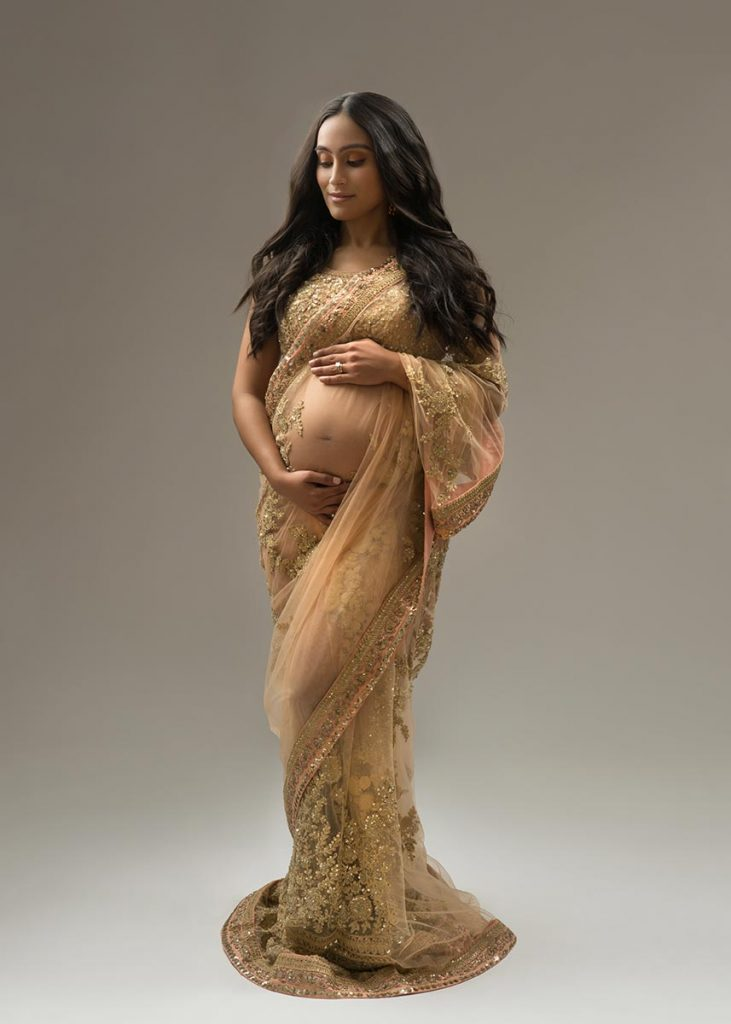 Pregnant woman wearing a traditional indian dress
