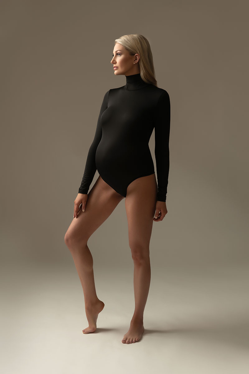 Turtleneck bodysuit worn by a pregnant woman