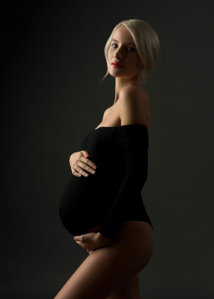 Artistic pregnancy photo black dress