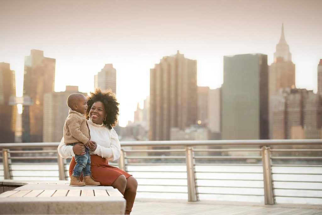 A mother shares a happy moment near the East River in NYC