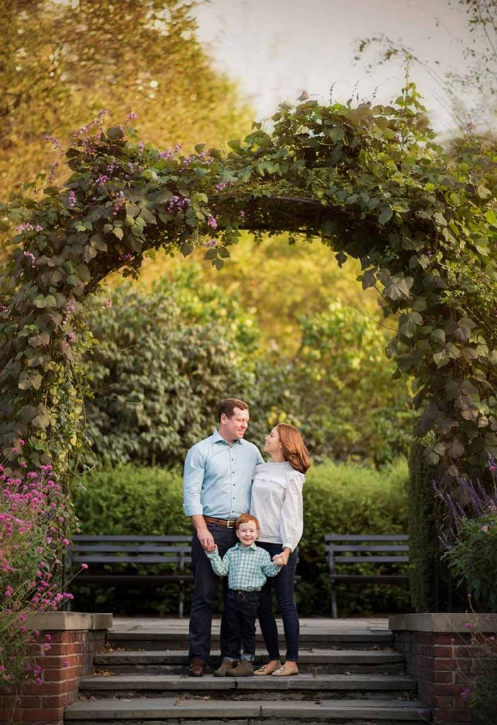 A portrait of a NYC family set amidst the Conservatory Gardens in NYC