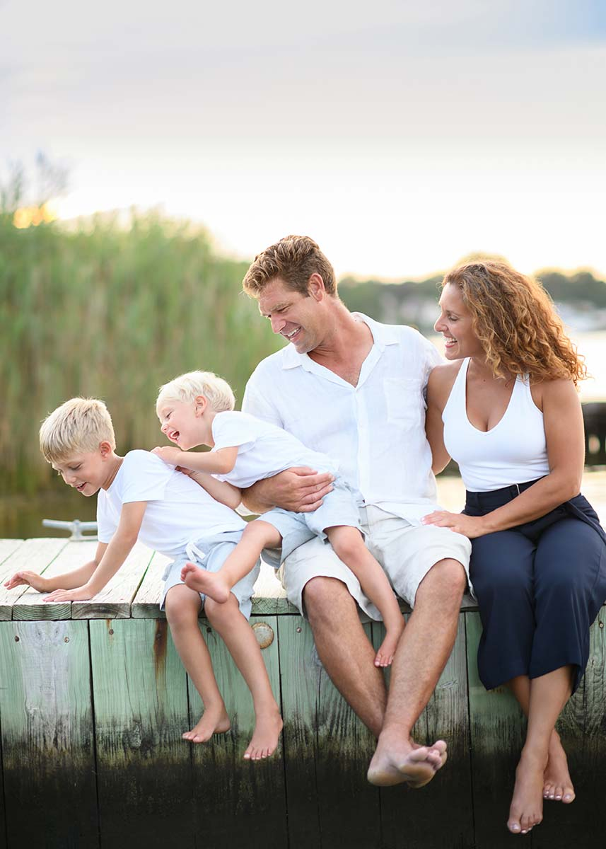 Candid moment shared by this family taken at a marina in the Hamptons