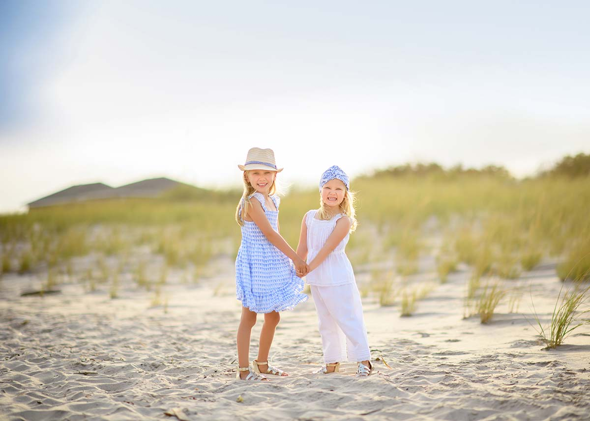 Two sisters smiling at beach in Southampton NY