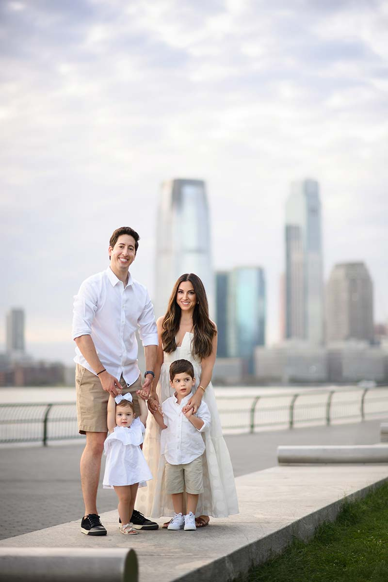 Modern portrait of a family in Battery Park NYC