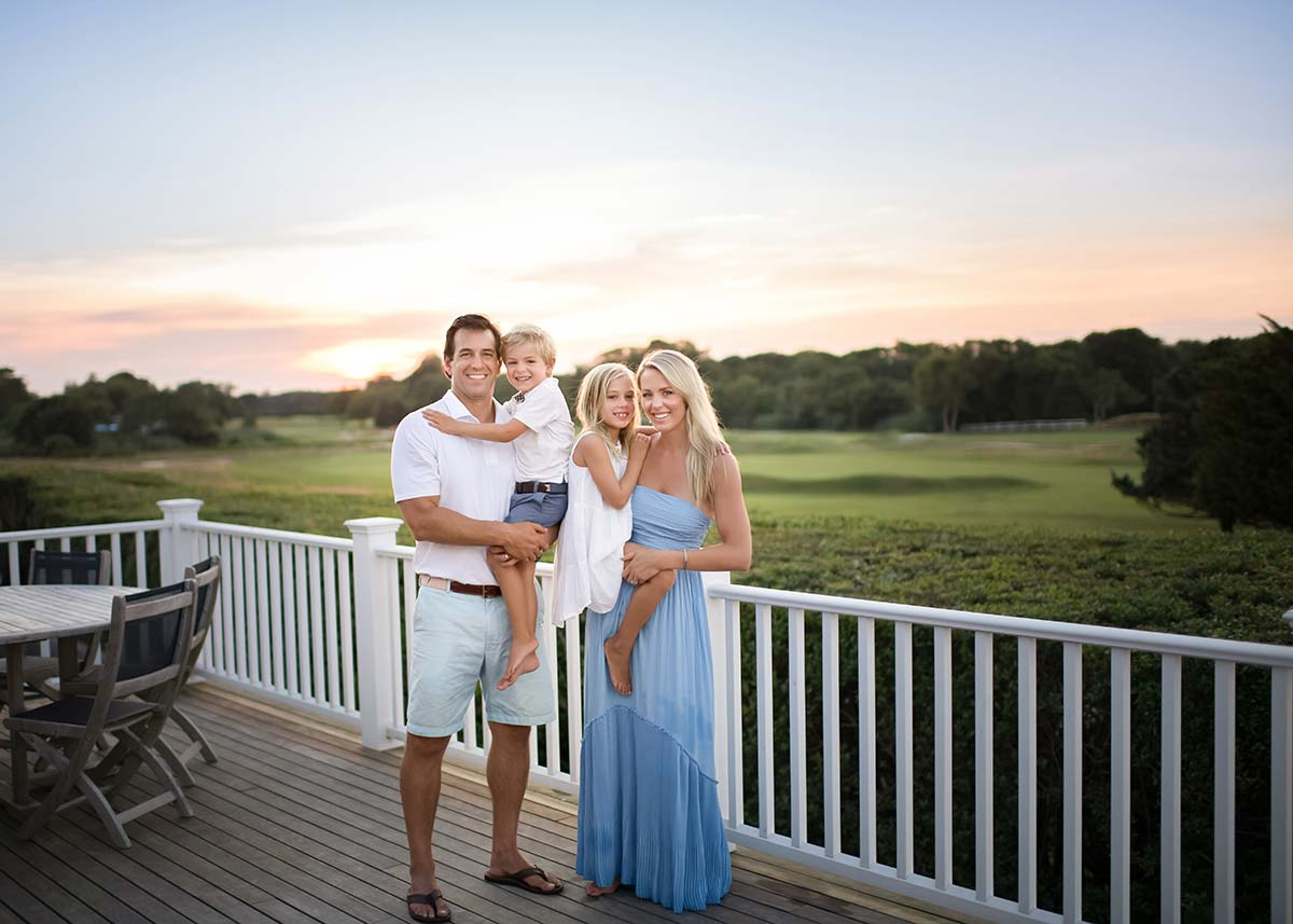 Sunset themed family portrait with a golf course in Westhampton