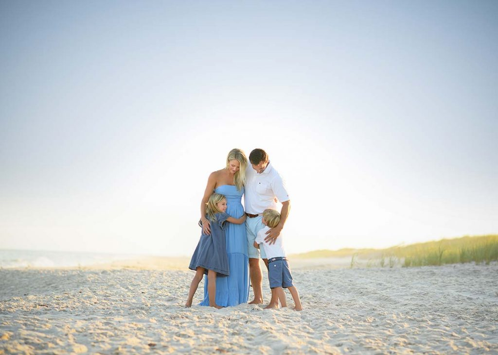 Beautiful photograph of a family taken during a sunset at a beach in Southampton