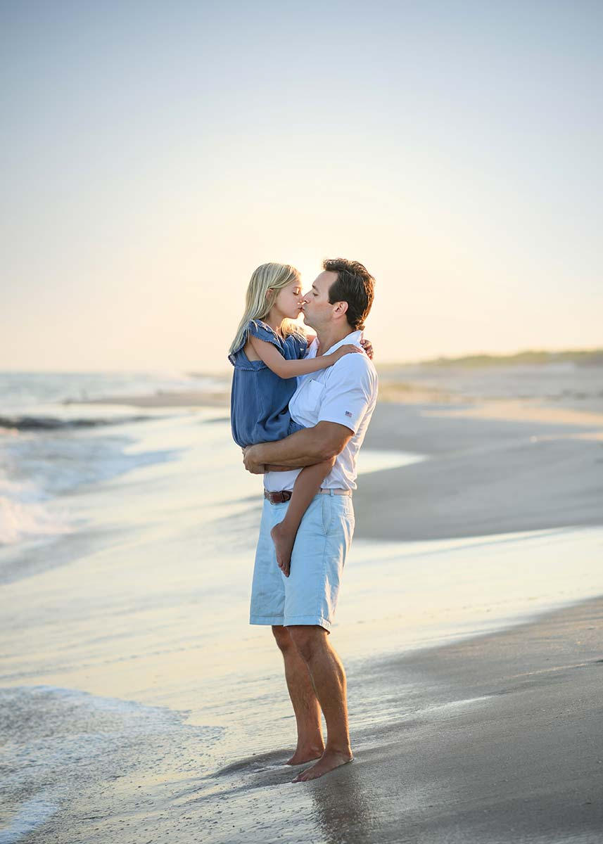 Father holding his daughter on a beach in Easthampton NY