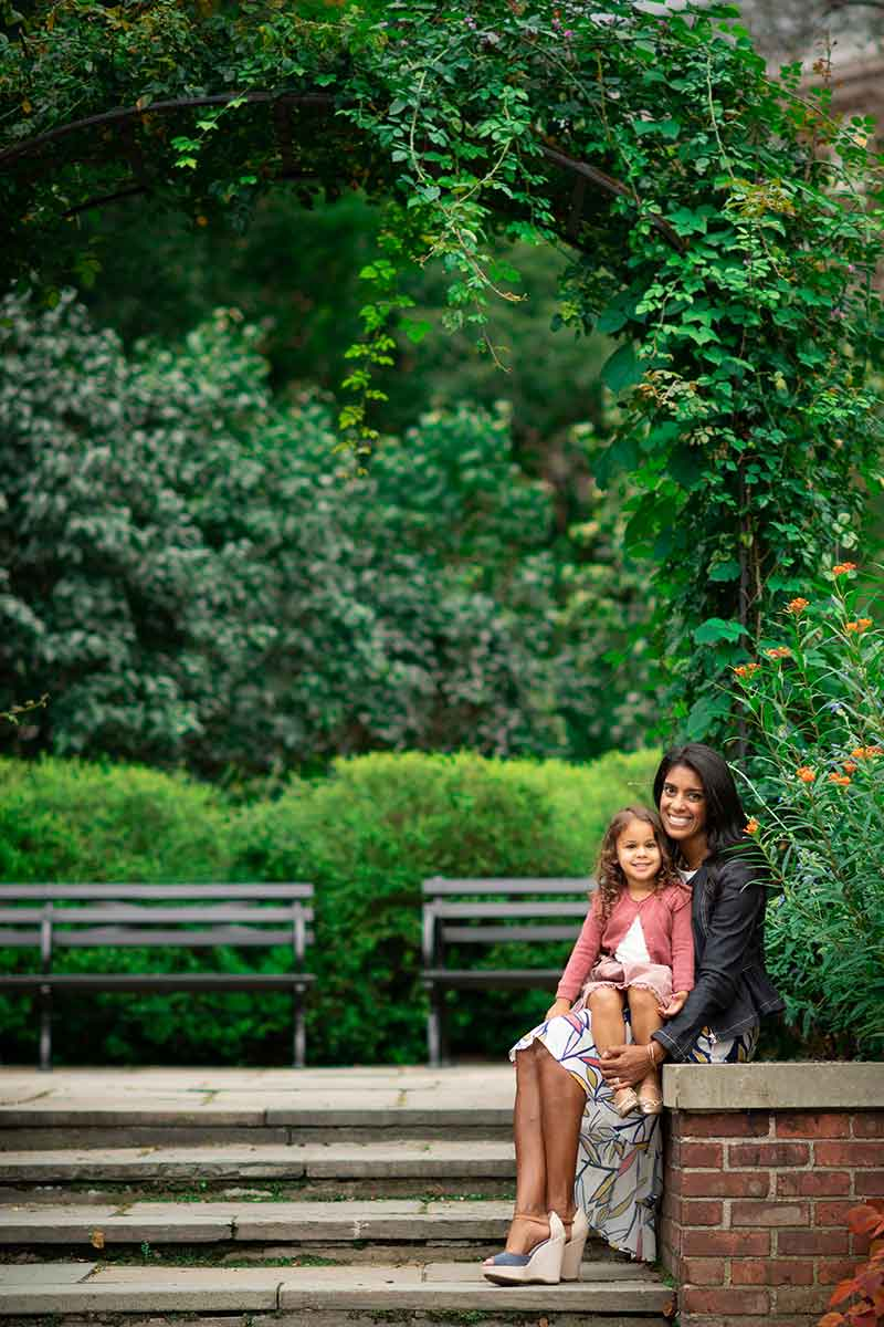 A mother and a daughter sharing a smile in NYC's Central Park